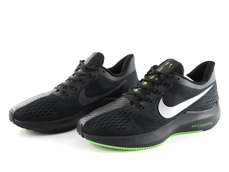 Мужские кроссовки Nike чёрные с зелёным.