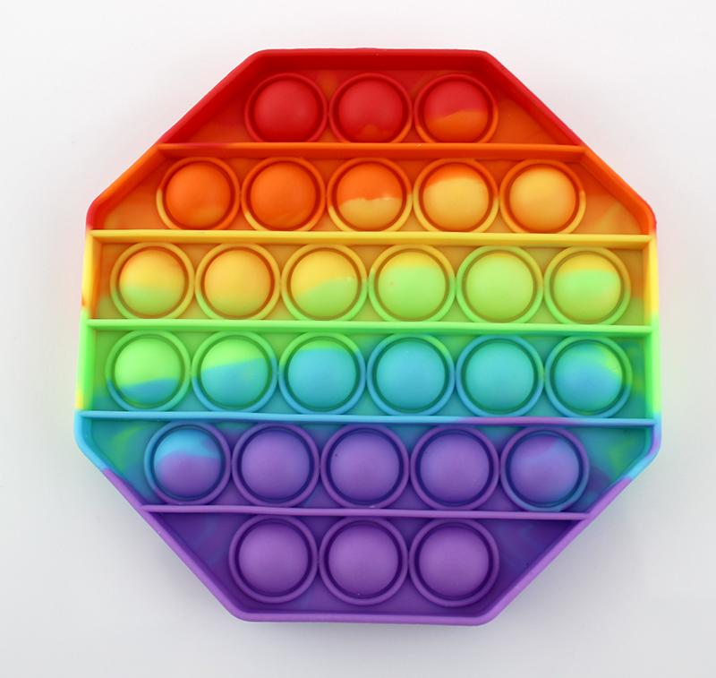Игрушка антистресс Pop it в форме восьмиугольника.